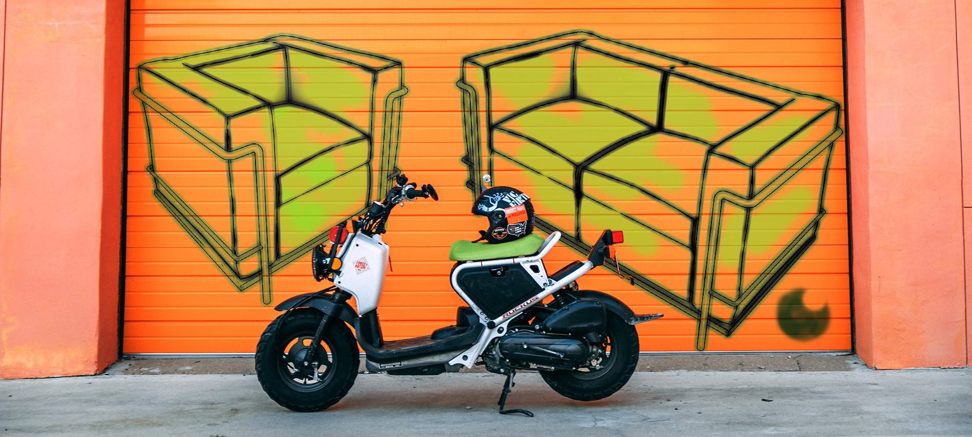 Image of motorcycle and helmet in front of graffiti of couches