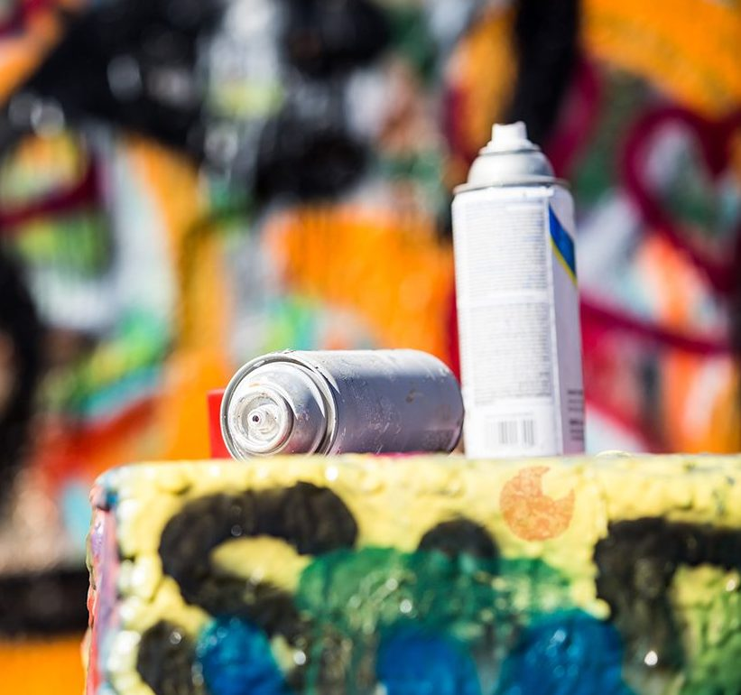 spray cans on ledge